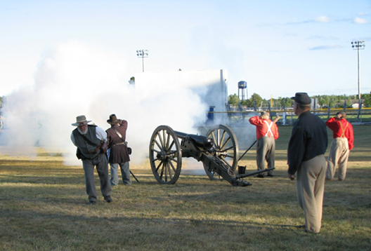 NWTers Demonstrate Artillery on the Ball Field in Capac.